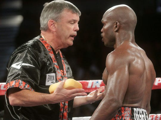 Teddy Atlas gives instructions to Timothy Bradley Jr. during Bradley's fight against Brandon Rios during their WBO Welterweight Championship bout at the Thomas and Mack Center in Las Vegas, Nevada on November 7, 2015. Bradley won the bout via a TKO and he retains his WBO Welterweight belt and is now 33-1-1 12 KOs.