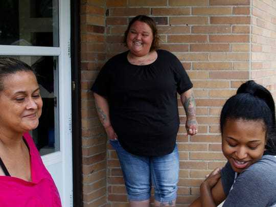 """""""It's perfect for them, and it's a big relief,"""" Danielle Askew, middle, said Tuesday, June 20. 2017.  """"It's the first time in a long time where she (Shylah Outlaw) won't be struggling to pay the rent.""""   The mother and daughter spent about six months homeless, when 16-year-old daughter Tamara, right,  made a plea on social media for help after her mom attempted suicide last spring."""