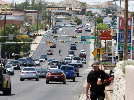 Traffic flows Friday afternoon along North Mesa Street