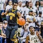 Eron Harris ,14 of MSU takes a tumble trying to gain control of the ball after knocking it away from Peter Jok ,not pictured, of Iowa during their game Thursday January 14, 2016 in East Lansing. KEVIN W. FOWLER PHOTO