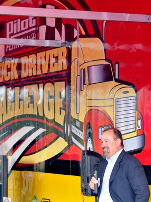 Mark Hazelwood, executive vice president of Pilot Flying J standing beside of the Pilot Flying J Truck Driver Challenge 18 wheeler rig addresses the NASCAR 18-wheel truck drivers.