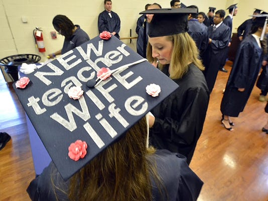 Penn State York graduate Summer Warner of Spring Grove details her plans after graduation on her mortar board. Warner was prepping for the ceremony backstage at the Pullo Center for the Performing Arts on campus where spring commencement was held Friday, May 8, 2015.
