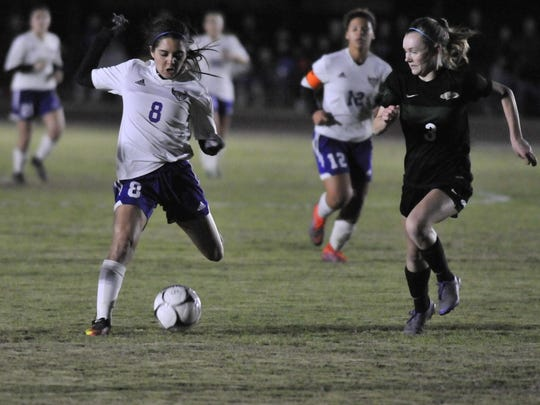 Mission Oak's Miranda Jimenez, left, drives the ball down field against Liberty in a Central Section Division III girls soccer championship game on February 24, 2017. Michael Alvarez