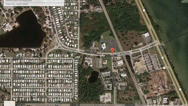 A woman was briefly trapped beneath a golf cart near Barefoot Boulevard and Ron Beatty Boulevard in Micco.