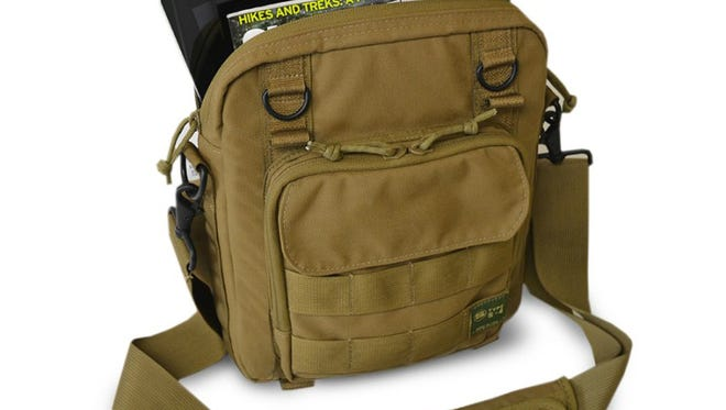 This khaki tablet bag is part of the Type S-4 collection from Skooba Design. Made with water-repellant, heavy-duty nylon, and shoulder straps attached to heavy-duty metal clips and D-rings, each bag look like it's ready for anything, whether a hike up a mountain or a short walk to the office.
