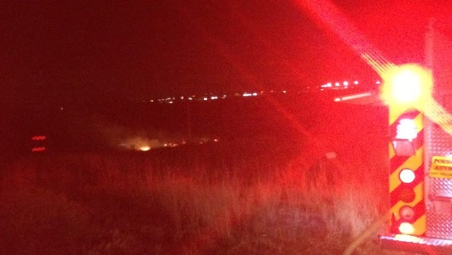A wildfire burns near the CSU atmospheric science building at Laporte Avenue and Overland Trail on Monday night. The fire was contained.