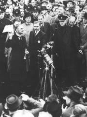 "British Prime Minister Neville Chamberlain declares the agreement reached with Adolf Hitler means ""peace in our time,"" on Sept. 30, 1938."