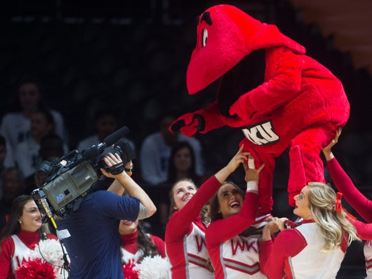 Western Kentucky cheerleaders hold their mascot up