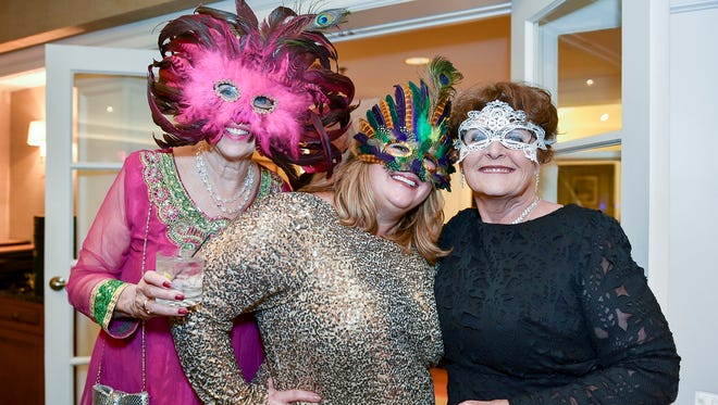 From left, Susan Clifford, Charity Parsons and Judy Gay chose beautiful masks for the Masquerade Ball.