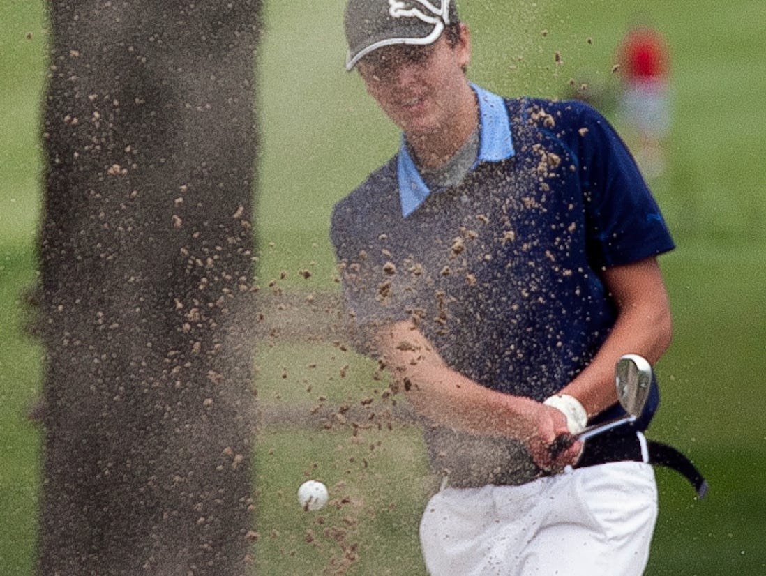 Howards Grove's Jonny Probst Howards chips the ball out of the sand during WIAA division 3 action Wednesday May 27, 2015 at the Town and Country Club in Sheboygan.