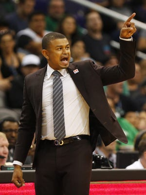 Phoenix Suns head coach Earl Watson signals to his players during the fourth quarter against the Boston Celtics at Talking Stick Resort Arena March 5, 2017. Suns won 109-106.