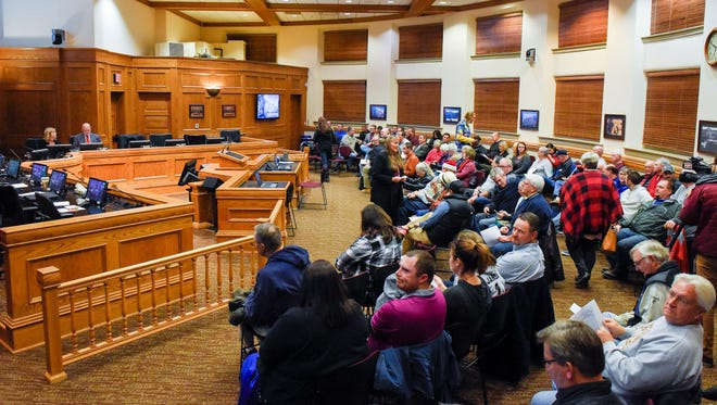 Residents sit at Carnegie Town Hall during a Sioux Falls city council meeting on Tuesday Dec. 19, 2017.