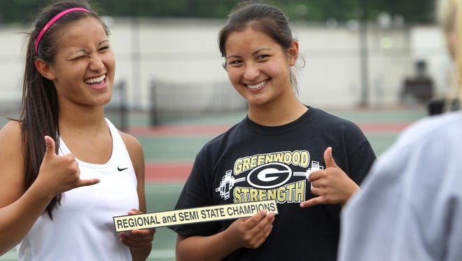 Twin sisters Jackie, left, and Jade Kawamoto, juniors at Greenwood High School, who won the No. 1 and No. 2 Singles matches, respectively, against Terre Haute South in the girls high school tennis semistates at Center Grove in Greenwood on Saturday, May 25, 2013, ham it up as their picture is taken following the match. Greenwood won all three singles matches and lost both doubles matches to advance to the semifinals. The Park Tudor girls won four out of five matches against East Central at the same place and time to advance as well.