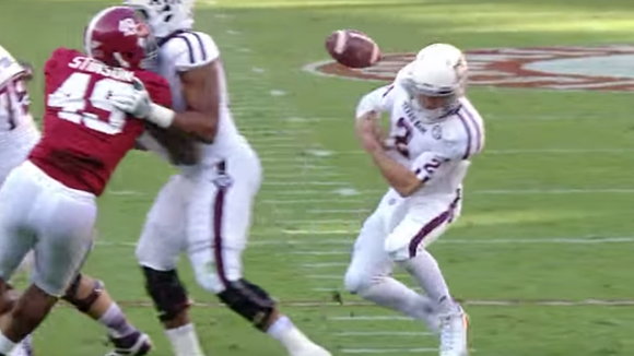 Johnny Manziel right before he recovers a ball that