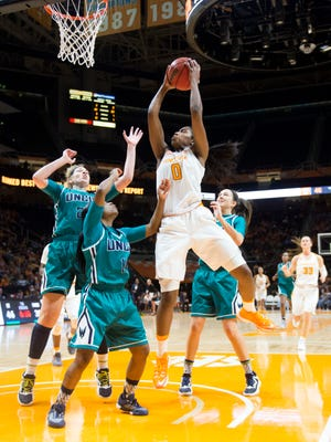 Tennessee's Jordan Reynolds attempts to score while defended by UNC Wilmington's, from left, Jenny DeGraaf, Jasmine Steele, and Madison Raque at Thompson-Boling Arena on Thursday, December 29, 2016.