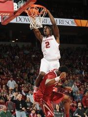 Arkansas forward Adrio Bailey (2) dunks over Alabama