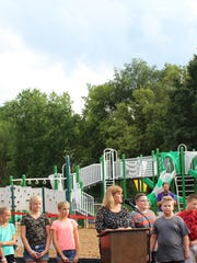 Kelly Elementary Principal Kathy Gutzwiller thanks the community for its support in creating the new playground before its unveiling on Aug. 15.