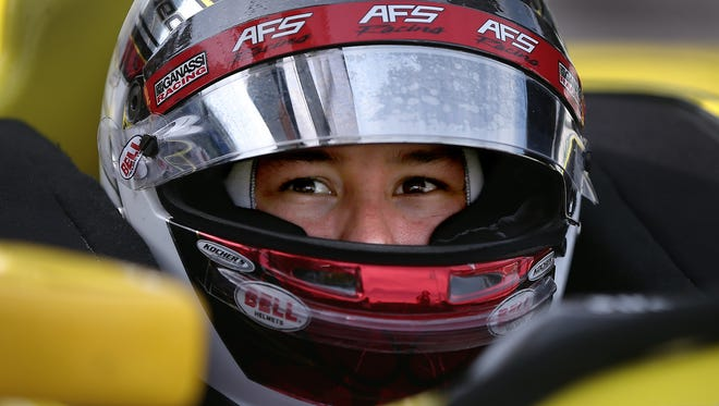 Chip Ganassi RacingÕs Sebastian Saavedra (8) sits in his car waiting on his crew during practice on pole day for the Angie's List Grand Prix of Indianapolis Friday, May 8, afternoon at the Indianapolis Motor Speedway.