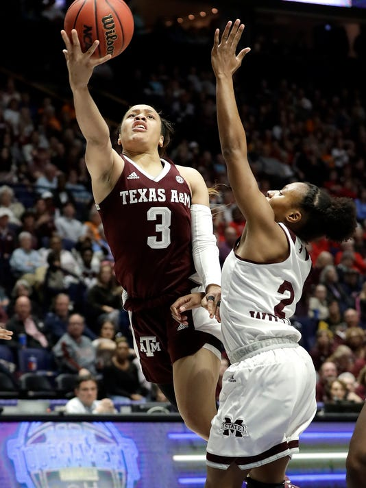 Texas A&M's Chennedy Carter (3) drives against Mississippi State's Morgan William (2) in the first half of an NCAA college basketball semifinal game at the women's Southeastern Conference tournament, Saturday, March 3, 2018, in Nashville, Tenn. (AP Photo/Mark Humphrey)