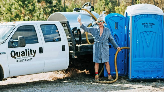 Randy Reece, dressed as the Cousin Eddie character from National Lampoon's Christmas Vacation movie, reenacts the famous sewage scene during a 2018 photoshoot to promote his Quality Septic business.
