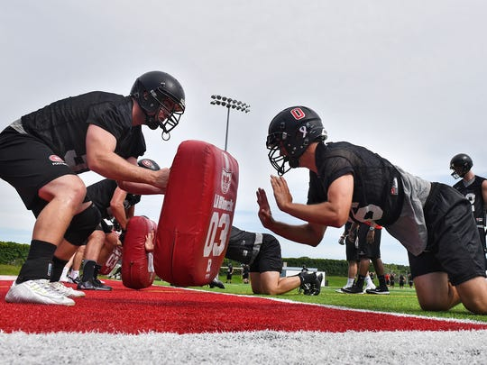 St. Cloud State players take part in a drill during practice Thursday, Aug. 11, at Husky Stadium in St. Cloud.