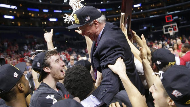 Wisconsin players lift up head coach Bo Ryan as they celebrate their 85-78 win over Arizona in a college basketball regional final to advance to the Final Four in the NCAA Tournament in Los Angeles.