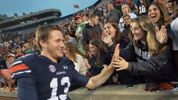 Auburn quarterback Sean White (13) high fives fans after Auburn defeated San Jose State 35-21 in the NCAA football game on Saturday, Oct. 3, 2015, at Jordan-Hare Stadium in Auburn, Ala. 
