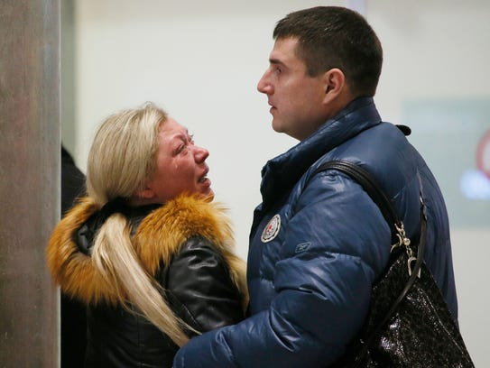Relatives react after a Russian airliner with 217 passengers