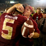 Jameis Winston hugs Jimbo Fisher after the Seminoles' dramatic win over Notre Dame in 2014.