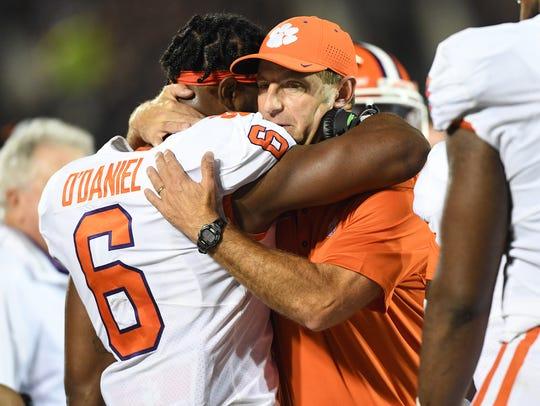 Clemson head coach Dabo Swinney hugs linebacker Dorian