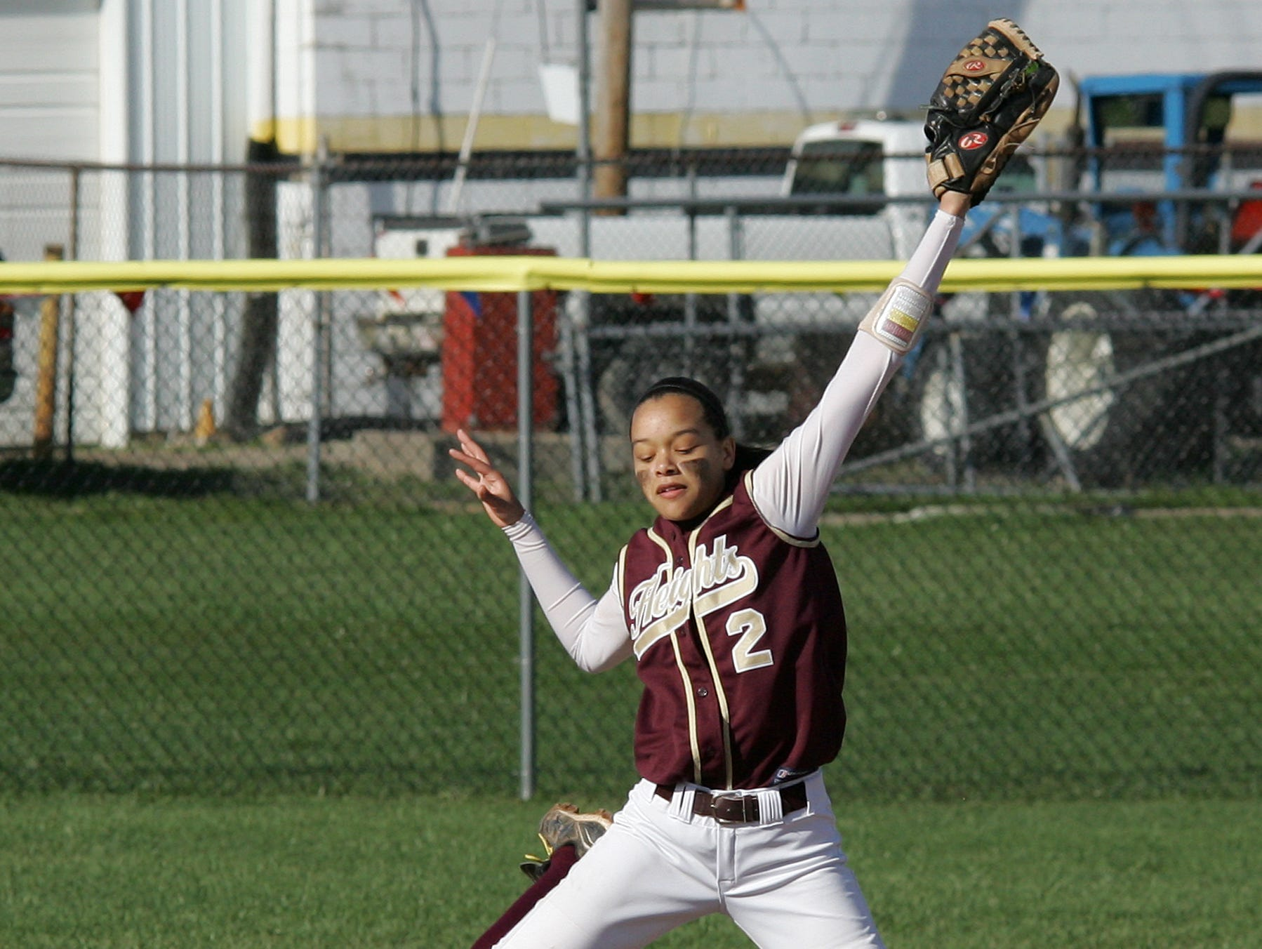 Watkins Memorial's Baylee Small slides under Licking Heights' Kayla Myrthil at second base Friday during Watkins' 14-11 victory. The Warriors trailed 11-3 in the fifth inning before rallying.