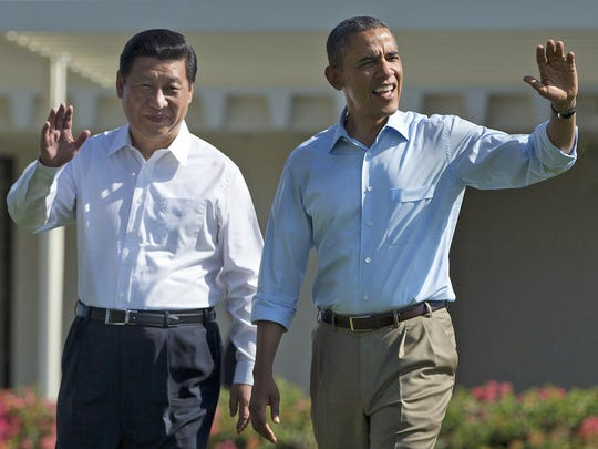 President Barack Obama and Chinese President Xi Jinping walk at the Sunnylands Center and Gardens in Rancho Mirage on June 8, 2013. The two leaders negotiated a modest climate deal at Sunnylands, paving the way for a larger agreement 17 months later.
