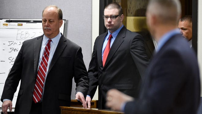 Former Marine Cpl. Eddie Ray Routh, center, enters the court for his capital murder trial at the Erath County, Donald R. Jones Justice Center in Stephenville Texas, on Tuesday, Feb. 24, 2015. Routh, 27, of Lancaster, is charged with the 2013 deaths of Chris Kyle and his friend Chad Littlefield at a shooting range near Glen Rose, Texas. (AP Photo/The Dallas Morning News, Michael Ainsworth, Pool)
