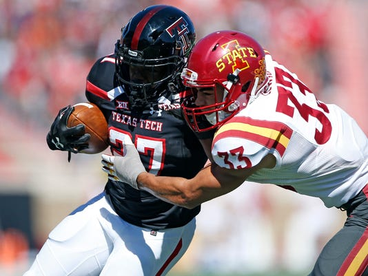 Iowa State's Braxton Lewis (33) tackles Texas Tech's Demarcus Felton (27) during an NCAA college football game, Saturday, Oct. 21, 2017, at Jones AT&T Stadium in Lubbock, Texas. (Brad Tollefson/Lubbock Avalanche-Journal via AP)