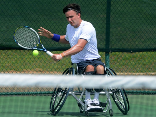Gordon Reid, of Scotland, returns the ball to Maikel Scheffers, of the Netherlands Sunday during the finals of the 12th annual Pensacola Open Tennis Championship at Roger Scott Tennis Center. Reid beat Scheffers 6-4,6-3.
