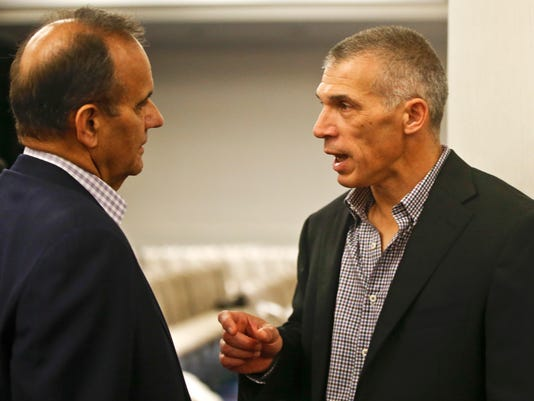 New York Yankees manager Joe Girardi, right, talks with former Yankees' manager and current Major League Baseball executive Joe Torre at the MLB winter meetings Tuesday, Dec. 9, 2014, in San Diego. (AP Photo/Lenny Ignelzi)