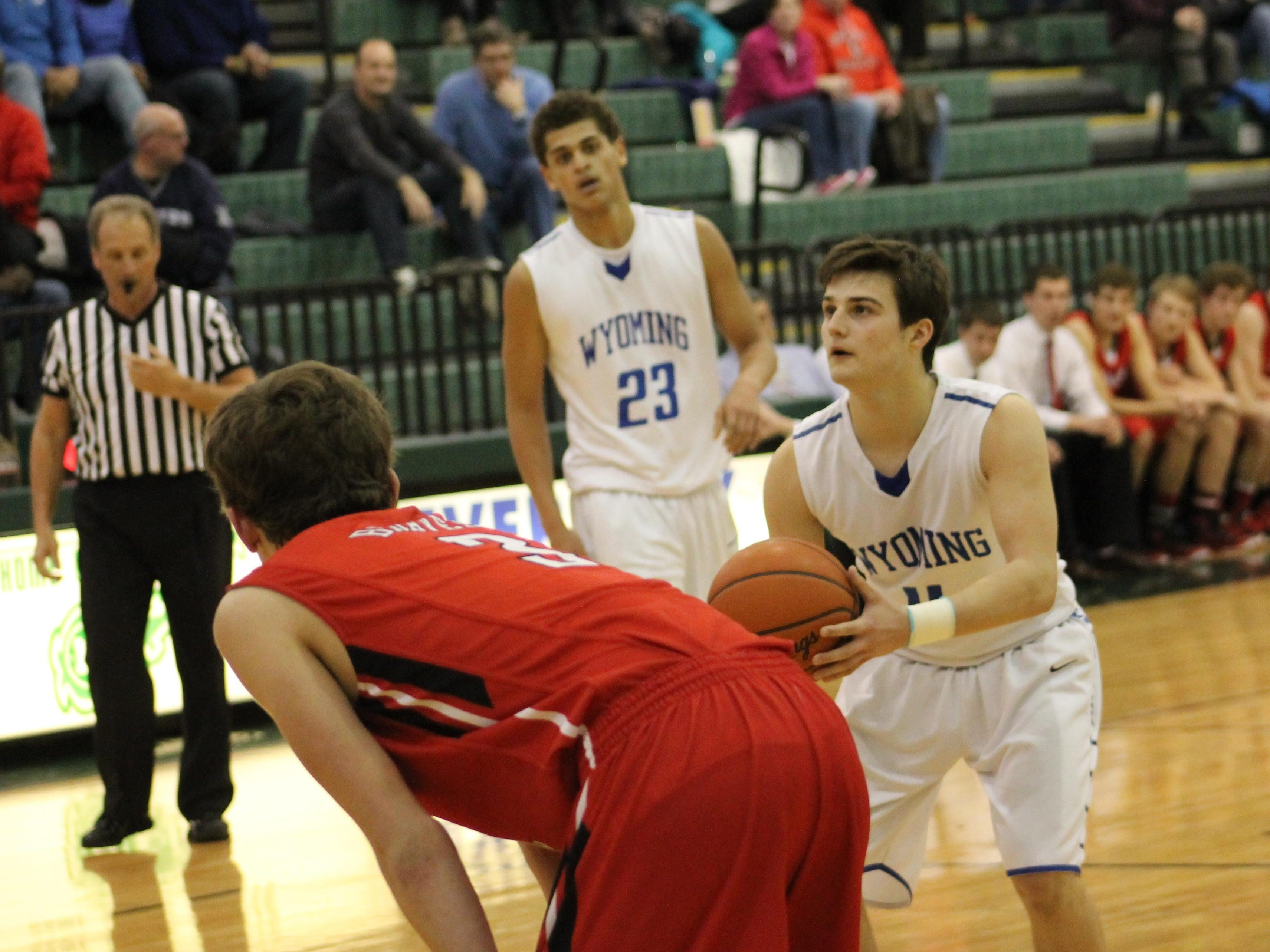 Wyoming's Jake Edmonds eyes the basket from the charity stripe last March as Garyn Prater (23) looks on.