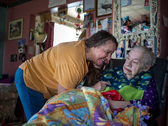 Pam Williams leans down to talk with her mother, Patsy, as they sit in the living room together Wednesday, April 26, 2017 at their Port Huron home. Patsy, who has late-stage dementia, Alzheimer's and Parkinson's, gets help from an in-home caregiver two days a week.