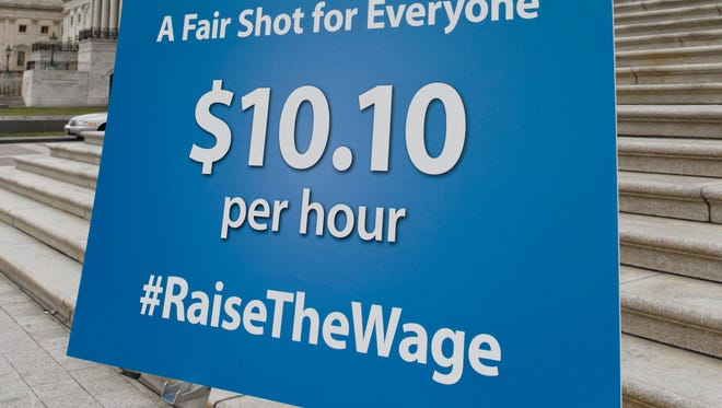 A chart prepared by Senate Democrats rests on an easel at the Capitol before a news conference urging approval for raising the minimum wage, in Washington, Wednesday, April 2, 2014. In the coming days, the Senate could debate a plan by Iowa Democrat Tom Harkin that would gradually lift today's minimum wage of $7.25 an hour to $10.10 by 2016. President Barack Obama wants to increase the hourly minimum wage as part of an election-year economic agenda focused on working families.