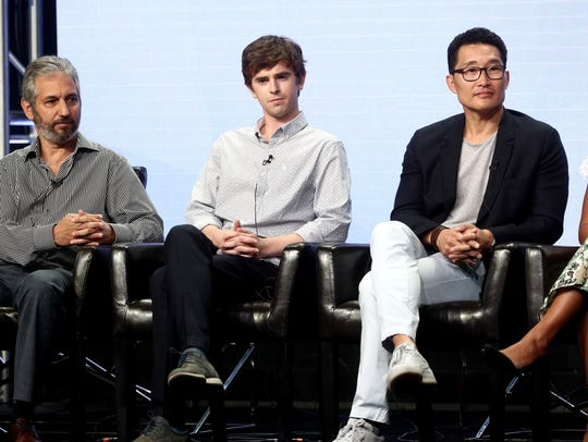 "Daniel Dae Kim, right, and fellow executive producer David Shore brought ""The Good Doctor"" to ABC. That's the show's star, actor Freddie Highmore, in the middle."
