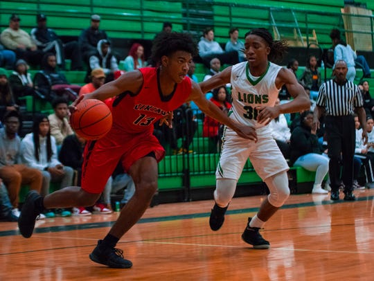Northside's Seneca Knight (13) dribbles the ball through