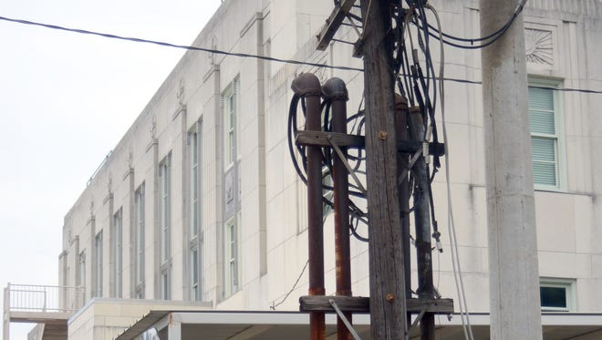 A fire that started here on an electrical pole outside the Federal Courthouse on Murray Street   closed the building  Thursday, September, 18, 2014. --Tia Owens-Powers/ towens@thetowntalk.com