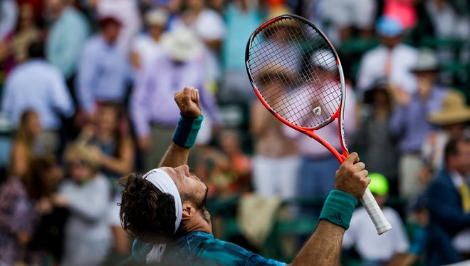 Juan Monaco reacts after defeating Jack Sock during the singles final of the U.S. Men's Clay Court Championship tennis tournament