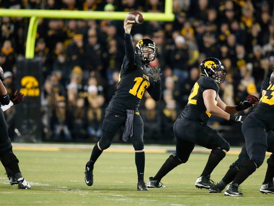 Iowa junior quarterback CJ Beathard fires a pass against
