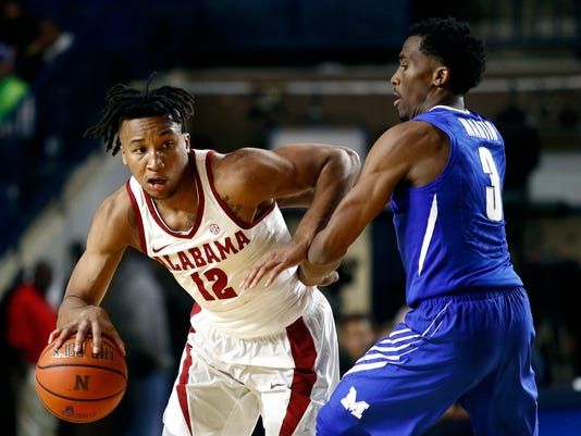Alabama guard Dazon Ingram, left, drives against Memphis guard Jeremiah Martin in the second half of an NCAA college basketball game at the Veterans Classic tournament in Annapolis, Md., Friday, Nov. 10, 2017. (AP Photo/Patrick Semansky)