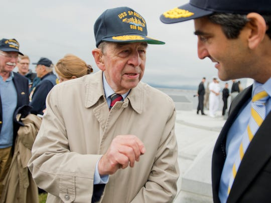 Former U.S. Navy Capt. Albert Perry of Richford talks with Mayor Miro Weinberger after a ceremony announcing the naming of a fast-attack submarine after the Green Mountain State.