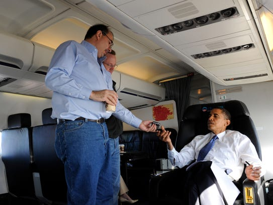 In this Oct. 18, 2008, file photo, Barack Obama sits