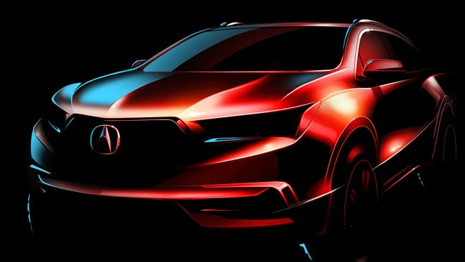 the look of the 2017 Acura MDX is teased in this photo released by the Honda luxury brand