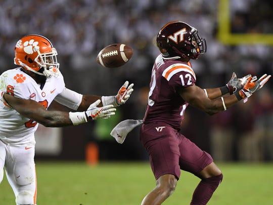 Clemson linebacker Dorian O'Daniel (6) intercepts a pass intended for Virginia Tech wide receiver Henri Murphy (12) during the 4th quarter on Saturday, September 30, 2017 at Lane Stadium in Blacksburg, VA. O'Daniel returned the interception for a touchdown.