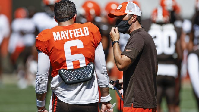 Cleveland Browns head coach Kevin Stefanski talks with Baker Mayfield (6) during practice at the NFL football team's training facility Wednesday, Aug. 19, 2020, in Berea, Ohio.